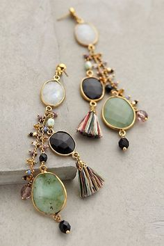 I like the mixed colors of the tassels with the simple filigree bead cap on this pair of earrings from Anthropologie. It is difficult to design with this many components and have it all work. Bravo!