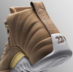 los angeles 6d5e4 096ef This shoe features a flooded, suede Vachetta upper with pops of gold  hardware for a new luxury take on the XII. The WMNS Air Jordan 12 Retro