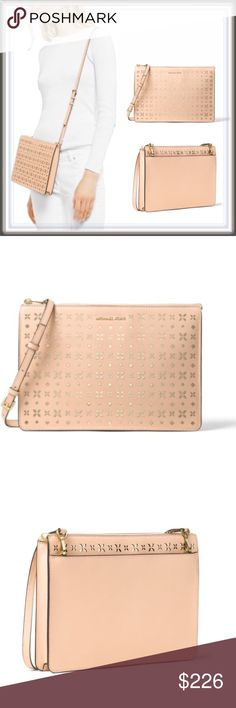"FREE SHIP NWT Michael Kors Perforated Leather Bag OFFER $159 :FREE SHIPPING (weekend only) ➖NWT ❌NO TRADE ➖BRAND : Michael Kors  ➖STYLE: RARE Ava Large convertible clutch is reimagined in prettily perforated Saffiano leather.   ➖Top zipper closure ❗️Converts to a shoulder / crossbody bag for added versatility.      ➖100% Leather       ➖11.5""W X 8""H       ➖22.25"" Handle Drop       ➖Adjustable Strap: 21.25""-23.75""       ➖Interior: 1 Large Pocket, 6 Card Slots       ➖Exterior: Back Snap Pocket…"