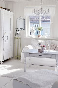 Shabby chic living room with white wood floors