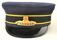 Railroad Trainman's Cap from the Pennsylvania railroad with enameled hat badge, size 7-3/8. size: 7-3/8