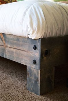 Love the base of this DIY bed! However,you do not want to use a solid piece of plywood under your mattress because a mattress needs to breathe so it doesn't mold. #diybedframesplywood