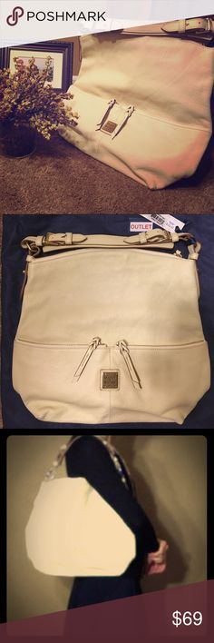 """Dooney & Bourke satchel Dooney & Bourke """"bone"""" colored satchel.  This handbag is from their outlet.  It's brand new, never used, still with tags on it.  The retail price was $235, and the outlet had an original listed price of $188.  It will come with the original navy blue dust bag.  It looks really great paired with a dark navy outfit.  Enjoy!  :) Dooney & Bourke Bags Satchels"""