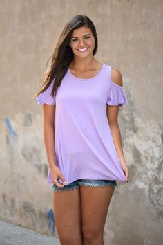 This basic top can easily be dressed up with a layering necklace. True to size w/a looser fit. Model is 5'10'' and a size 9 wearing a small. Small 0-5 Medium 6-9 Large 10-13 Material: 95% Rayon 5% Spa