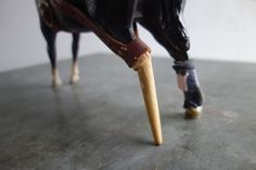 """Pegleg, detail.  9"""" high.  Proud Pegleg was undaunted by a broken leg.  Her prosthetic allowed her a full and graceful life."""