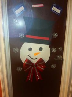 Christmas dorm door decor- snowman cut from poster board with ribbon from Christmas shop https://www.ohiodominican.edu/Campus-Life/Housing-and-Dining/Residence-Life/Residence-Life/