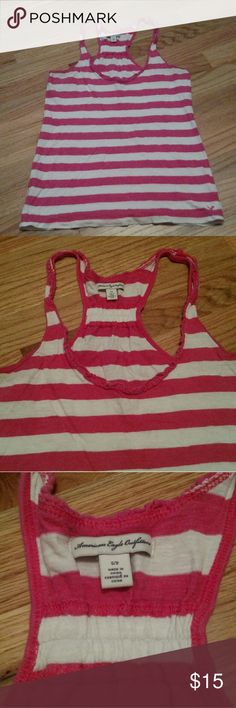 AEO stipped tank top Great condition. Has decorative small ruffle around the neckline.  Ask any questions. American Eagle Outfitters Tops Camisoles