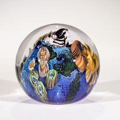 Inhabited Planet Paperweight 🌍  Photo credit: Josh Simpson Contemporary Glass  Available at : purchase.megaplanet.com