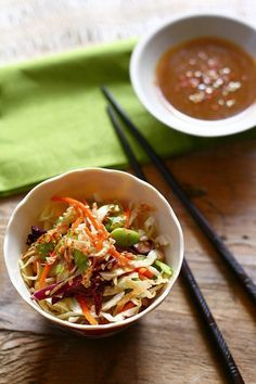 Spicy Soy Sesame Dressing:     1/4 cup light soy sauce  1/2 cup brown sugar  1/4 cup sesame oil  2 tablespoons almond butter  2 tablespoons apple cider vinegar  1 tablespoon rice vinegar  2 teaspoons toasted sesame seeds  1-2 tablespoons red chili flakes  Salt and sugar to taste