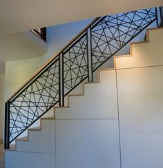 Artistic stair rail guard rail hot rolled steel railing bees wax finish on steel hot rolled steel 522 industries five twenty two industries Modern Stair Railing, Stair Railing Design, Stair Handrail, Staircase Railings, Modern Stairs, Balcony Railing, Banisters, Steel Stairs Design, Indoor Railing