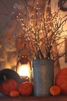 Fall Decorating Ideas: Mix natural branches and lighted ones in a galvanized bucket to create this festive fall decor that will add a lovely glow to your space.