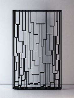 Panel--metal grille / lapped geometric shapes suggested by metal lines + neg space