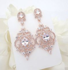 Luxurious Rose Gold finish earrings are set with Swarovski Pure Brilliance stones in a vintage filigree design. You will fall in love with these beauties ! Available in 2 finishes.  Earrings measure 2-1/8 L x 1 W  Matching necklace: https://www.etsy.com/listing/253506757/crystal-bridal-necklace-rose-gold  Matching bracelet: https://www.etsy.com/listing/456883848/rose-gold-bridal-bracelet-crystal