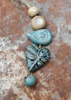 Dragonfly Love… Handmade ceramic dragonfly heart bead set in blues and creams. The original! Gaea Ceramic Bead and Art Studio Blog / gaea.cc