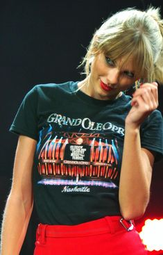 Taylor looking cute and stunning in her grand Ole Opry tee shirt.