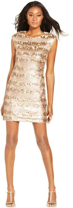 Adrianna Papell Cap-Sleeve Sequin Sheath at Macy's.   PRICE WAS: $159.00  NOW ON SALE: $111.30 by Adrianna Papell     Get gilded in Adrianna Papell's stunning party dress, complete with gold-toned sequins in a striped motif. The full-length zipper at the back adds a sexy touch. Polyester; lining: polyester Dry clean Imported Crew neckline Exposed back zipper with hook-and-eye closure Cap sleeves Tonal sequins in striped motif throughout Sheath silhouette Lined Hits at thigh