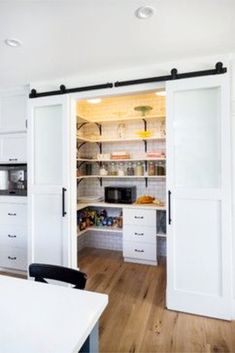 Pantry - farmhouse kitchen.  Love the sliding white barn doors for this kitchen pantry
