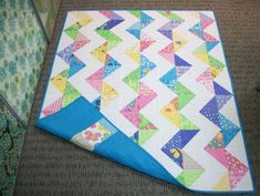 """made with two charm packs of fabric called Butterfly Fling.  It's an easy quilt to make, lots of hst's made with the 5"""" squares and put together in a zig zag pattern."""