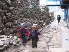 Little Sherpa kids hurrying home from school, Namche Bazaar, Nepal.