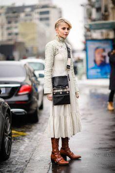Caroline Daur wears a white dress during Paris Fashion Week Womenswear Fall/Winter 2018/2019 on March 1 2018 in Paris France