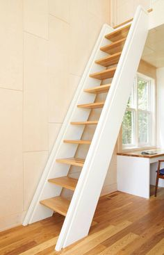 13 Stair Design Ideas For Small Spaces | A super vertical staircase, like this one, frees up space around the stairs but feels more sturdy than a completely vertical ladder.