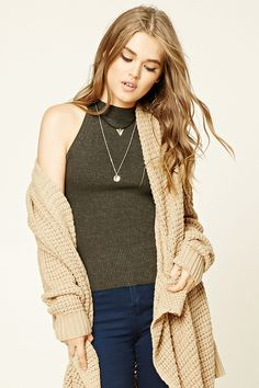 Style Deals - A ribbed knit sleeveless sweater top with a mock neckline.