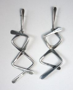 """Art Smith. Silver, ca.1950's. One of the leading modernist jewelers of the mid-twentieth century, Smith trained at Cooper Union. Inspired by surrealism, biomorphicism, and primitivism, Art Smith's jewelry is dynamic in its size and form. Although sometimes massive in scale, his jewelry remains lightweight and wearable. See """"From the Village to Vogue: The Modernist Jewelry of Art Smith""""."""