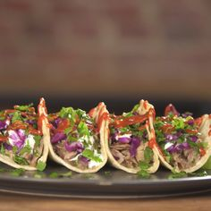 These succulent Mojo Pulled Pork Tacos are a delicious way to change up your Taco Tuesday.