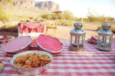 Western party ideas. I like the layered tablecloths in the background.