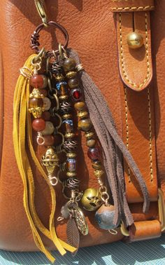 This handmade tassel charm can be used on your purse, backpack, zipper, wherever youd like to add some charm! Its made up of antiqued brass chain