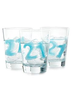 Say cheers to the New Year with these festive number ice cubes. Or... USE THEM FOR A BIRTHDAY! Freeze water tinted with food coloring (or juice) in number-shaped ice trays.