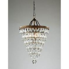 This cone-shaped chandelier will look great in your foyer or entryway. Glistening clear crystals descend the the antique copper and iron bas...