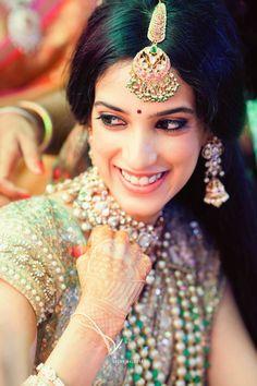 Maang Tikka - Green and Pink Maang Tikka | WedMeGood | Bridal Portrait with Natural Makeup, Maang Tikka with Pink Stones and Hanging Pearls, Polki Jewelry #wedmegood #indianbride #indianwedding #bridal #portrait #maang #tikka #jewelry