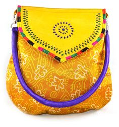 Bag is beautifully decorated with vintage style.* leather flap is decorated to give ethnic look.* Color: Multicolored.* One zipper enclosure pocket inside.* Leather flap cover top of the bag.* To hold itcomfortablybag comes with long handle.