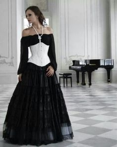 Simple peasant blouse style off the shoulder dress and a contrasting corset.  Simple dark sexy