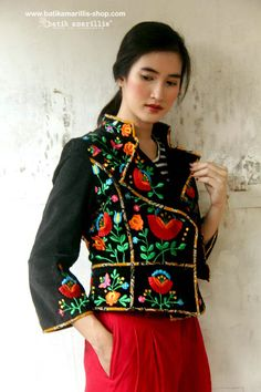 Available SOON at Batik Amarillis webstore http://batikamarillis-shop.com Batik Amarillis's Ryder Jacket in classic Hungarian embroidery Such a beautiful design for assymetrical part of riding and military inspired jacket, it features criss cross batik piping and lining. You can change the look by playing with the front  button and the front flap of the jacket!