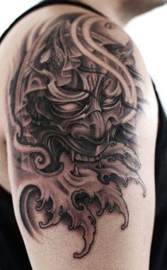Shoulder black and grey Hannya Mask tattoo