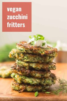 These vegan zucchini fritters are seasoned up with garlic, dill and a hint of cumin, pan-fried to a crisp, and served with a sprinkling of fresh chives. Delicious on their own, but also perfect for dipping! #veganrecipes #zucchini #fritters Vegan Apps, Healthy Vegan Snacks, Vegan Appetizers, Vegan Breakfast Recipes, Delicious Vegan Recipes, Vegetarian Recipes, Vegan Meals, Vegan Lunches, Eating Healthy