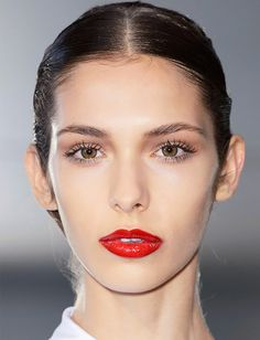 Flawless skin, doll-like lashes, and bright red lips at Stephane Rolland's fall couture show