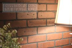DIY:  Faux Brick Wood Wall Panels - sold in sheets @ Lowe's for $25 per panel. This is an inexpensive way to completely change the look of a room and an easy fix for a damaged wall! Via Snippets of Design