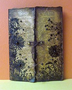 natashakara (Natasha)   heat embossed the dandelion frame on dictionary paper, I then used my heat gun to burn the paper. I also added extra distressing with distress inks. I then sprayed it with gold pearl water to add some golden shimmer.