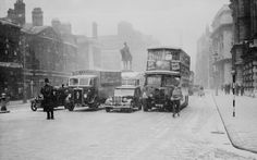 A policeman directs traffic on a snowy day in Whitehall, London, 19th December 1938
