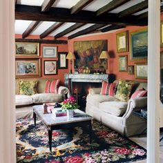 Paolo Moschino's country house | 19th C Bessarabian rug, cushions in Rayure Broderie & Hamot Rouge by Madeline Castaing for Edmond Petit