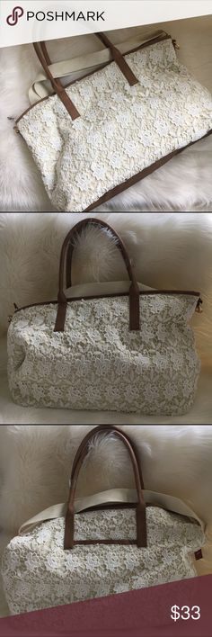 Adorable tote by Merona Light tan canvas with a white floral cotton embroidery over lay with tan vegan straps and tan vegan bottom panel. Measures 19.5W x 13.5 tall.  Shoulder strap included by Merona. New! 🚫trades Merona Bags Travel Bags