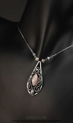 Peach moonstone and diamond necklace  wire wrapped by IMNIUM, $159.00
