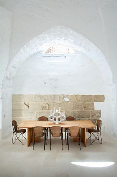 Ludovica Serafini and Roberto Palomba, who work as Ludovica+Roberto Palomba, commissioned a dining table of their own design from Exteta and paired it with Abanica chairs by Oscar Tusquets for Driade. The ceramic centerpiece is by Emilia Palomba, Roberto's aunt.
