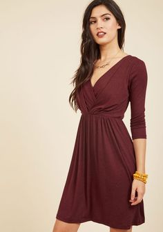 Once you've said goodnight to your evening attire, grab a late night snack with friends in this soft, jersey knit dress! In heather maroon hue, this frock features a dual-layer front wrap detail, a V-neckline, and haute half sleeves - it's a comfy-chic piece you'll look forward to wearing.