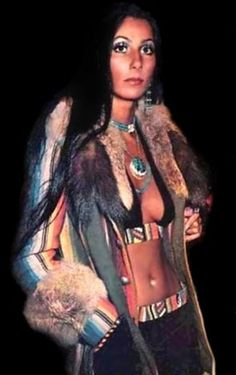 My Uniform:  Fake Fur Trimmed Coat, Swim Suit Top, Cool Jewelry, Low Slung Jeans, Straight Hair Parted In The Middle...Voila!  BoHo Chic!