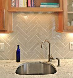 Checkout this Herringbone Back-splash by RJK Construction, Inc.  We love the simplicity of the design. To get started on your kitchen backsplash design, set up an appointment with #TileSensations today!