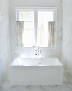 Elegant And Simple Marble Clad Bathroom With Freestanding Rectangular Tub Cafe Curtain